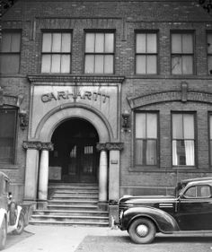 Entrance to Carhartt's first Corktown plant at 1605 Michigan Ave. A broken window suggests that the building, vacant for eight years by that point, was already decrepit. Photo, dated May 1, 1940 (Corktown History / carhartt-1940 by vegan27, via Flickr)