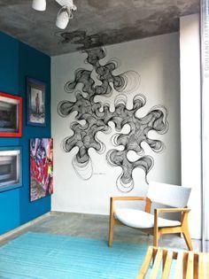 WallART subindo pelas paredes da Elgin Mobili & Design. Decoração por Roberto Borja.