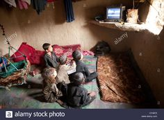 Afghan kids watching TV in a slum in Kabul Stock Photo, Royalty Free Image: 51111511 - Alamy