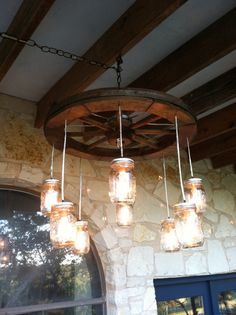 Wagon Wheel Mason Jar Chandelier by RusticChandeliers on Etsy, $300.00