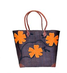 Mamy Flower - Vines Raffia Basket, Tote, Bag is Made of Raffia and Straw along with leather handles.   This colorful tote can be used as a beach bag, a shopping basket or for storage.   It's made by the artisan women from Madagascar, Africa.   Dimensions: 14W x 10.5H x 6.5D 16W x 13H x 8D 18W x 15H x 9.5D