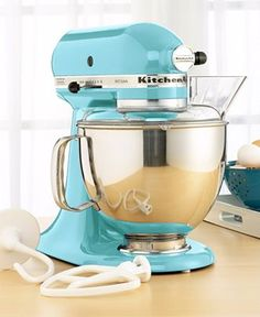 I am so in love with this color of KitchenAid mixer!  I want this one....someone want to buy our boring grey one?  LOL  I would keep this out on the counter for decoration!