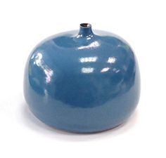 """Georges Jouve (1910-1964). Bottle """"apple"""" (1957) in blue tinged with grey with off center neck and matte black interior."""
