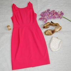 """J. CREW (Jumper) Dress Stunning day to night hot pink dress with knot detail on shoulders. Banded true waist and v-neck on rear of dress. Worn twice and in excellent condition. Shell is wool/spandex blend and lining is 100% polyester. Figure hugging. Shoulder to hem measures 36"""". J. Crew Dresses"""