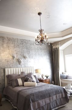 Antique silver leaf foil walls, metallic ceiling and Modello stencil on ceiling in antique silver leaf foil. For Parade of Homes 2011.