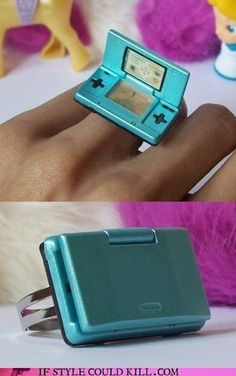 According to the maker, this minuscule handheld device is playing Animal Crossing. Not sure what would drive me more crazy: Perpetually doing errands for my woodland friends or not having this ring.