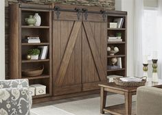 Today's interior style is highlighted in an entertainment wall unit. The Lancaster II Entertainment Wall by Liberty Furniture features sliding barn style doors with planked accents. Open shelf design on the pier units and console make this function for di Diy Christmas Decorations, Wood Entertainment Center, Entertainment Furniture, Lancaster, Murphy-bett Ikea, Barn Style Doors, Murphy Bed Plans, Murphy Beds, Liberty Furniture