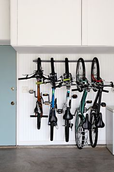@iheartorganize easy shows how to organize your bikes in the garage using the Monkey Bar Bike Rack