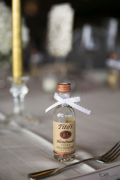 Alcoholic wedding favor idea - miniature airplane bottles  tied with ribbon {BDembowski Photography LLC}
