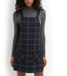 """Wear this check pinafore dress over a high neck long sleeve top for daytime chic - finish the look with block heel ankle boots.- All over check print- Double pocket front- Square neckline- Casual fit that is true to size- Mini length- Model is 5'8""""/176cm and wears UK 10/EU 38/US 6"""