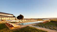 The Carneros Inn On the Sonoma/Napa border-from SF (45 min. w/out traffic). high end, but they really cater to children. 2 pools -1 adult-only 1 for kids (floats, toys, baby pools, hot tub) Can get good quality food and drinks poolside. There were a lot of kids there; 2 nice restaurants -kids were welcome at both. free bikes to use, some beautiful grassy areas where kids can play, bocce courts.