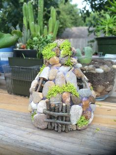 Fairy garden house made from plastic water bottle, pebbles and moss