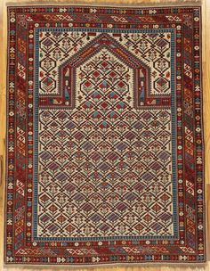 "Shirvan prayer rug,Eastern Caucasus,dated 1322=1904 Christian date, 5'.3""x4'.0"" (160x122 cm)."