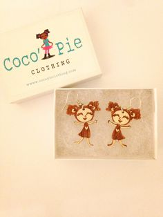 Hook earrings by Coco' Pie Clothing depicts little girl with afro puffs.  Promotes natural hair pride in our little girls.  What an amazing idea! <3