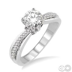 Round diamond engagement ring with a modern diamond accented shank.