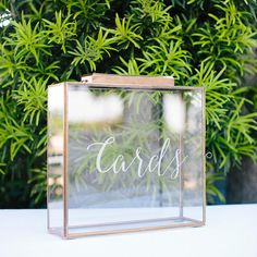 This beautiful card box is a perfect way to collect your wedding cards. The door latch is discreetly located so the box looks seamless. The slot is the perfect size for cards. We have added frosted vinyl cards lettering that can be removed after your wedding and the box can be used as a lantern. - Distressed gold and glass card holder with door - 13.75W x 13.75Hx 4D (opening 7 x 1.5) - Imported **** BACKORDERED UNTIL 3-20-17 *****