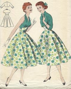 I bought this Beautiful halter neck 50s dress pattern. I love the simple elegance of the skirt starting under the bust line, no gathering just clean lines, it's a common thread in most of my patterns