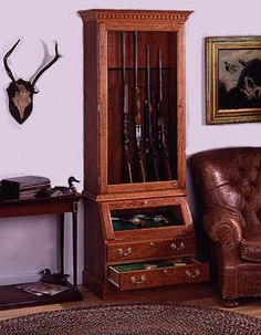 How To Build Your Gun Display Cabinet Many firearms are laid flat and slid under a bed, or they are… Wood Gun Cabinet, Gun Cabinet Plans, Cabinet Ideas, Woodworking Plans Porch Swing, Woodworking Projects, Teds Woodworking, Woodworking Classes, Wood Projects, Woodworking Joints