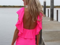 Love it all- the color, the ruffle, and the open back.