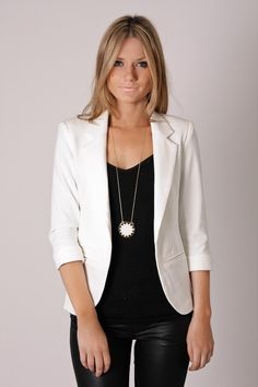 White blazer and waxed black jeans