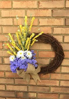 Welcome to Simply Elegant Floral Designs... This wreath looks like a bouquet of flowers collected from a field. The delightful purple, white,