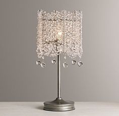 RH Baby & Child's Coco Crystal Table Lamp:Draped strands of faceted crystals form a glittering surround for our Coco Crystal Lamp's candelabra bulbs, evoking the ethereal elegance of Art Deco fashion.