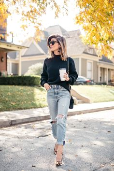 black sweater, distressed levi jeans, leopard pumps and gucci cross body