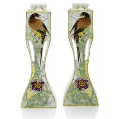 A  pair of Rozenburg two-handled eggshell porcelain vases, painted by W. P. Hartgring, 1905, square section body with flattened handles, both painted with two birds amidst flowering branches in shades of green, yellow, brown, and purple.