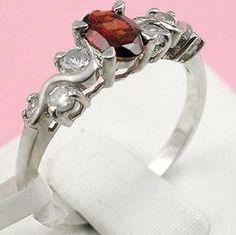Sell Sterling Silver Natural Garnet Ring, Blue Topaz Pendant ...