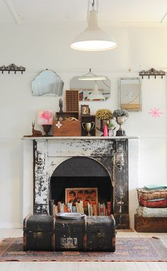 The fireplace? The books in the fireplace? The old trunk? The randomness on top of the fireplace? Sweet Home, Piece A Vivre, Fireplace Design, Fireplace Ideas, Fireplace Remodel, Fireplace Filler, Mantle Shelf, Fireplace Cover, Home And Deco