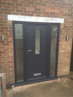 A traditional Flint Solidor Composite Doors with glazed side panels in a modern anthracite grey, satin glass and brushed aluminium handle and letter box. Installed in Nuthall, Nottingham.  For a free quotation call us on 01158 660066 visit http://www.thenottinghamwindowcompany.co.uk visit our showroom in West Bridgford.