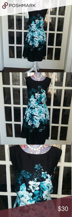 Stunning Leslie Fay Floral A-Line Dress EUC I absolutely love this dress. It is a size 16 by the designer Leslie Fay. The material is 100% cotton and it does come with a liner. The colors are black a beautiful turquoise color and white in a floral pattern. The dress is an a-line Style with the zipper in the back. The dress originally came with a belt and it is no longer with the dress period I have left the belt loops. Please message with any questions. Pristine condition. Thanks for…