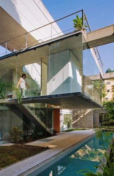 Container House Design of Carapicuiba house by Angelo Bucci & Alvaro Puntoni. Really nice use of plants within the space.