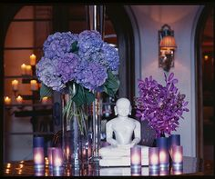 A grand display of purple hydrangeas and plum-hued votives makes an impact at the entranceway of your reception. Purple Wedding Decorations, Reception Decorations, Wedding Flowers, Table Decorations, Reception Ideas, Event Decor, Giving Flowers, Wedding Notes, Purple Flowers