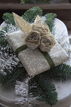 Even newspaper can make beautiful gift wrap. Fashion it into flowers and other embellishments. #giftwrap