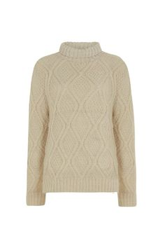 High-necked cable knit jumper. This cable-knit cocoon is hand-knitted from 100% wool and is perfect for cosy winter weekends.  Hannah is 5'9 and is wearing a size M.