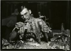 Glass worker making laboratory equipment in a Millville, New Jersey glass works, 1900-1937