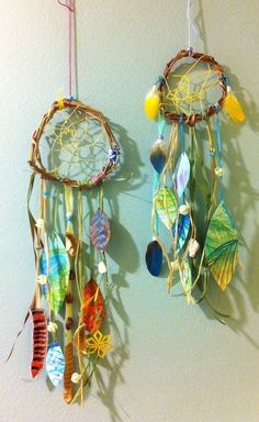 Inspiration for dream catcher/DIY decor    Island Hoppers grassy Hawaiian dream catchers with watercolor feathers, free shipping. $35.00, via Etsy.