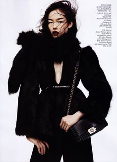 Black & White – Fei Fei Sun dons a wardrobe of black and white autumn looks for the November issue of Vogue China. Photographed by Josh Olins and styled by Alastair McKimm, Fei Fei is an elegant vision in sleek selects from the likes of Balmain, Alexander McQueen, Yves Saint Laurent and Stella McCartney. / Hair by Shon, Makeup by Maki