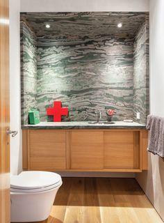 Severns put in a glass-block wall to separate the office from the guest bedroom, and created brand-new bathrooms.
