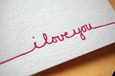 _____i love you_____ written in one continuous line from one side of the paper to the other.
