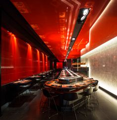 Inspired by the Fushimi Inari, Kyoto, Zen Sushi Rome is a striking venue in red and black, with clever use of natural materials such as marble & rice paper.
