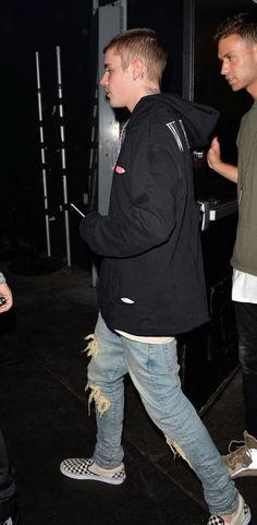 Justin Bieber wearing En Noir Distressed Jeans, Vans Checkerboard Slip-on and Off-White Native American Print Hoodie in Black