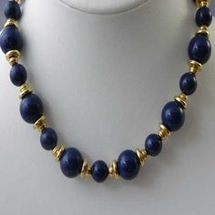 Vintage Avon gold and blue necklace Signed vintage Avon jewellery circa 1990s - 2000s Blue and gold colored beads that form this Avon necklace