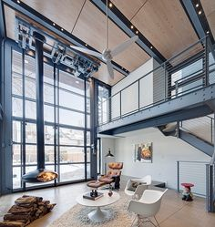 Sleek steel grate catwalk and mezzanine level clad in metal cable railing