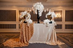 Orchids, crystals, black and white invitation, roses, gilded, gold wedding, linen, and glamour! Gorgeous VOGUE and Vanity Fair inspired styled shoot by Brass Tacks Events | Premiere Events | STEMS Floral | Studio 563 | Party Central | The Renaissance Hotel    http://www.PremierePartyCentral.com