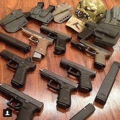 Table full of awesomeness. (posted by @_.50_cal_) #glockfanatics #glockporn #glockmods #glockperfection