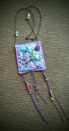 A personal favorite from my Etsy shop https://www.etsy.com/listing/291623869/butterfly-fabric-necklace-handmade-with