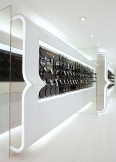 This futuristic store interior was created by Curiosity Design Studio. Bright & light design has amazing yellow colour accents, that gives an impression of a Showroom Design, Shop Interior Design, Display Design, Booth Design, Retail Store Design, Retail Shop, Retail Displays, Shop Displays, Window Displays