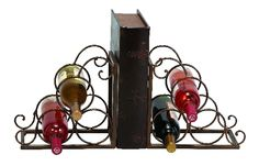 A wine rack and bookend all in one, this metal rack is made in cast metal with antique finish. Holds 6 bottles. $29.99
